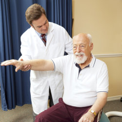doctor assisting old man